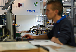 A Philips' technician works in the CosmoPolis ceramic metal halide lamp manufacturing division, at the Philips Lighting factory, in Turnhout, Belgium, on Friday, Oct. 15, 2010. (Photo © Jock Fistick)