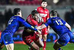 Scarlets' Steffan Hughes is tackled by Leinster's Noel Reid and Rory O'Loughlin<br /> <br /> Photographer Craig Thomas/Replay Images<br /> <br /> Guinness PRO14 Round 17 - Scarlets v Leinster - Friday 9th March 2018 - Parc Y Scarlets - Llanelli<br /> <br /> World Copyright © Replay Images . All rights reserved. info@replayimages.co.uk - http://replayimages.co.uk