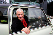 UK ENGLAND WILTSHIRE MALMESBURY 14SEP06 - Inventor and company chairman James Dyson (58) sits in a classic Mini car in front of the Dyson headquarters in Malmesbury, Wiltshire. His company - with its distinctive range of boldly-coloured products - is now said to be Europe's fastest growing manufacturer and has achieved sales of over £3bn worldwide, with £35m profit in 2000.<br /> Photography by Jiri Rezac<br /> Tel 0044 07947 884 517<br /> www.linkphotographers.com