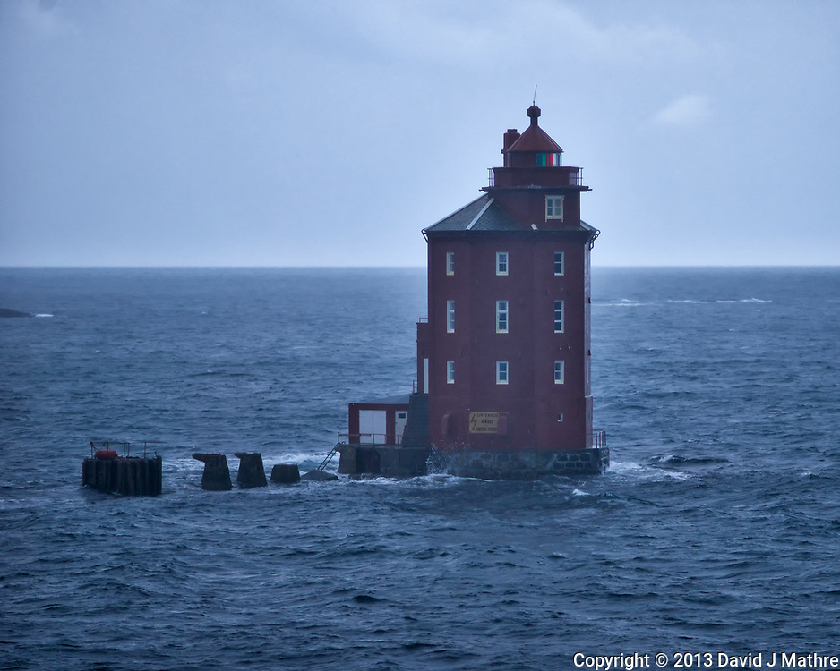 Kjeungskjær Lighthouse in Norway on a Cold Windy Rainy Winter Day from the Deck of the Hurtigruten MS Nordkapp. Image taken with a Nikon D800 and 180 mm f/2.8D lens (ISO 400, 180 mm, f/2.8, 1/320 sec).Kjeungskjær Lighthouse