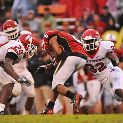 Sep 26, 2009; College Park, MD, USA; Maryland defensive back Anthony Wiseman (6) is tackled by Rutgers cornerback Zaire Kitchen (29) and cornerback Duron Harmon (32) during Rutgers' 34-13 victory over Maryland in NCAA college football at Byrd Stadium.