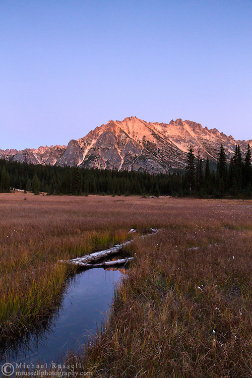 The Earth's shadow rises behind Kangaroo Ridge after sunset in the North Cascades of the Okanogan-Wenatchee National Forest in Washington State, USA.