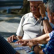 Older men playing dominoes in the park. San Juan Puerto Rico.