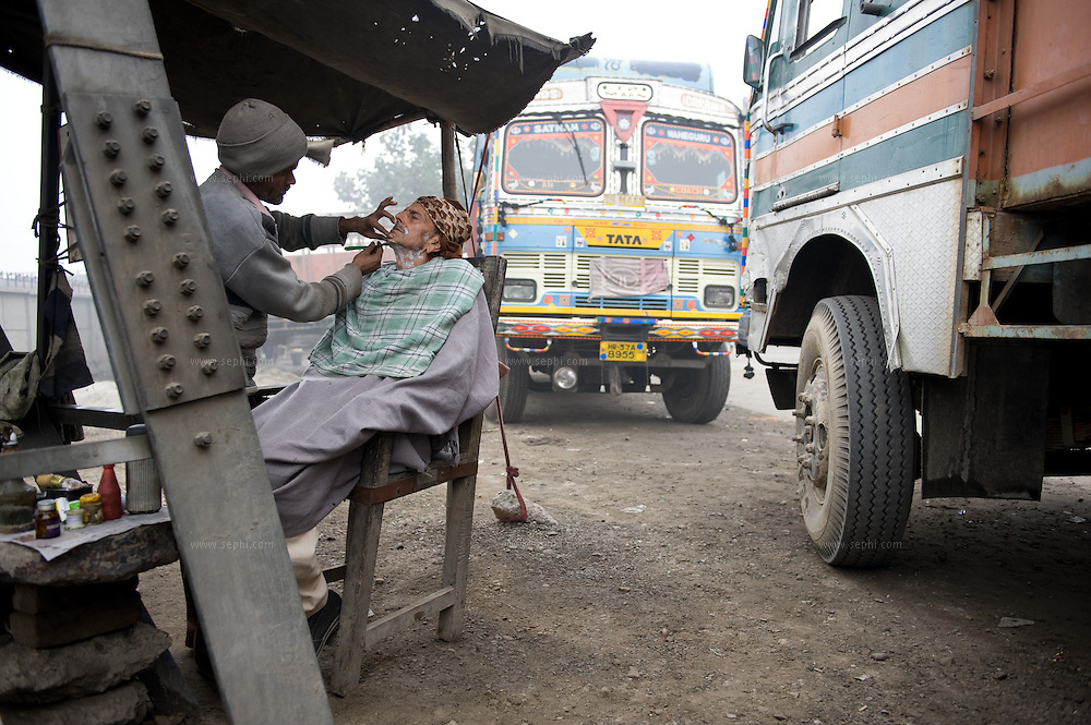a small parlor set up for truck drivers for there shave and hair cutting.