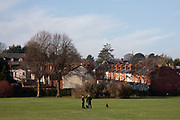 People out walking their dogs on Holders Lane Playing Fields in Moor Green in Birmingham, United Kingdom.