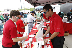 Philadelphia Eagles fans submit raffle tickets at the Sports Authority tent in the Head House Plaza during the NFL football training camp in Philadelphia, Sunday, July 28, 2013. (Photo by Brian Garfinkel)