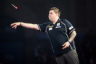 Michael Smith in action during the World Darts Championship at Alexandra Palace, London, United Kingdom on 1st January 2016. Photo by Shane Healey.