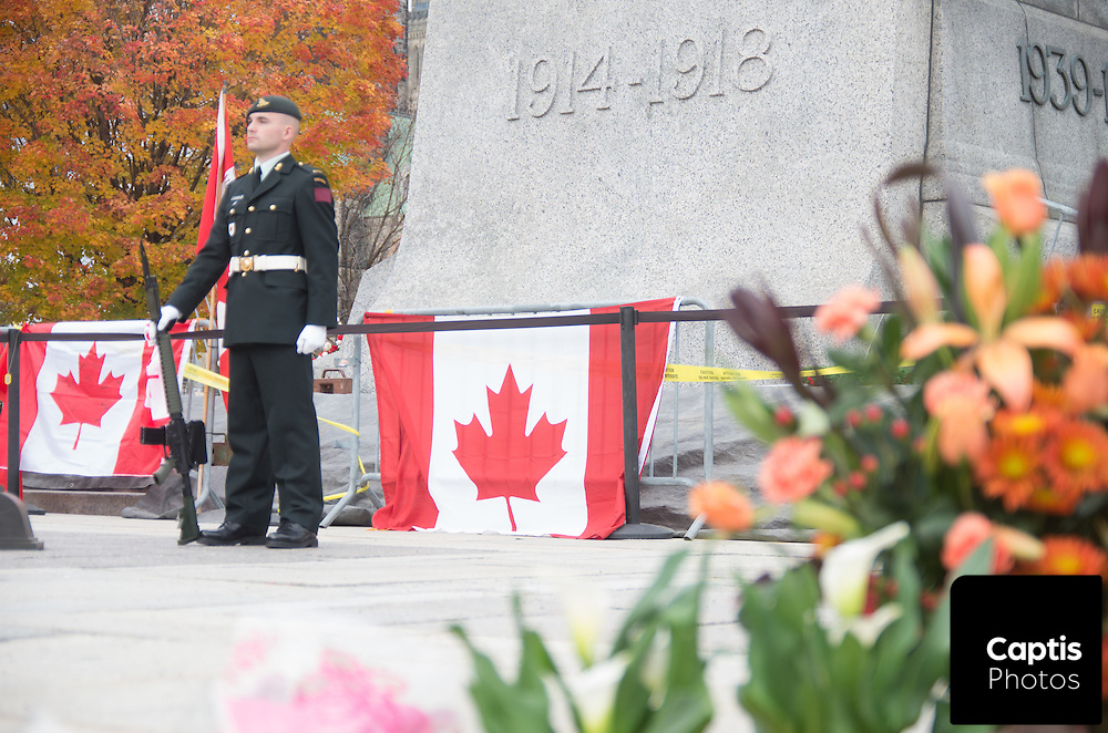 A solider stands on guard at the National War Memorial days after the fatal shooting of Cpl. Nathan Cirillo. October 25, 2014.