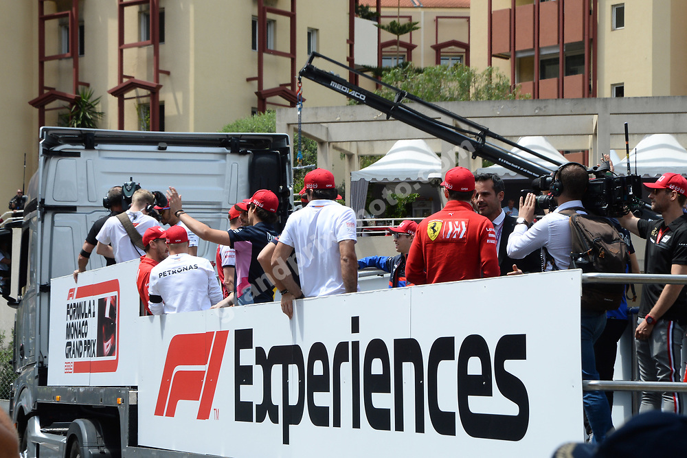 Parade with all drivers weating red caps in memory of Niki Lauda before the 2019 Monaco Grand Prix. Photo: Grand Prix Photo