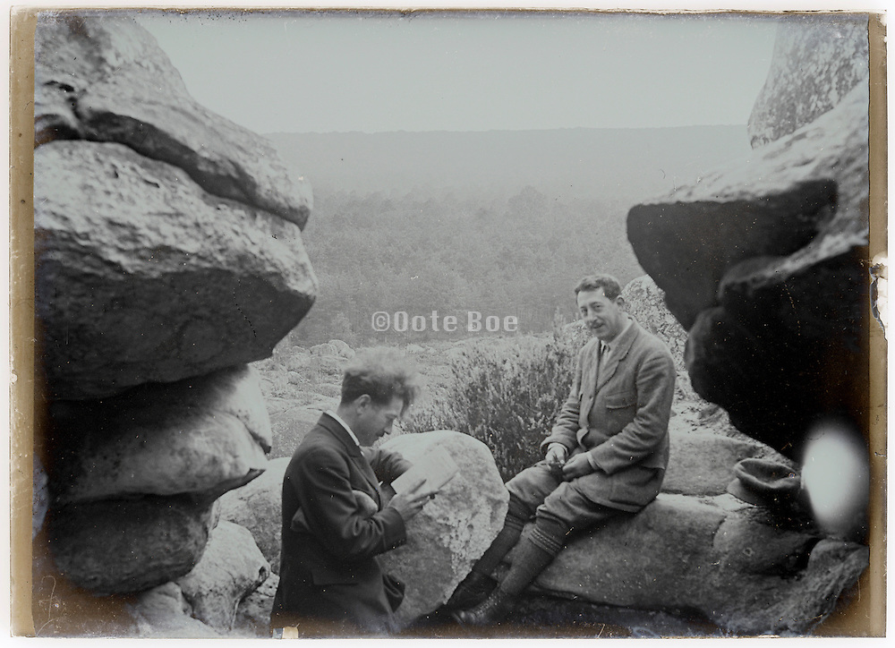 two men resting during a hiking trip early 1900s