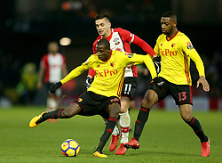 Watford's Abdoulaye Doucoure (left) and Southampton's Dusan Tadic (centre) battle for the ball during the Premier League match at Vicarage Road, Watford