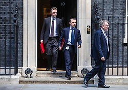 © Licensed to London News Pictures. 21/05/2019. London, UK. Secretary of State for Culture, Media and Sport Jeremy Wright QC (L), Secretary of State for Wales Alun Cairns (C) and Scotland Secretary David Mundell (R) leave 10 Downing Street after the Cabinet meeting. Prime Minister Theresa May is expected to make a statement to Paliament outlining changes to the Withdrawal Agreement Bill before it is brought back before Parliament. Photo credit: Rob Pinney/LNP