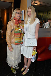 Left to right, SHONA WILKINSON and KATY BRAINE at a ladies lunch in aid of the charity Maggie's held at Le Cafe Anglais, 8 Porchester Gardens, London on 29th April 2014.