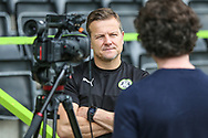 Forest Green Rovers manager, Mark Cooper being interviewed by TV during the Forest Green Rovers Press Conference and Training session at the New Lawn, Forest Green, United Kingdom on 12 May 2017. Photo by Shane Healey.