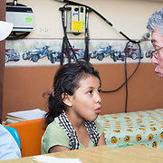CAPTION: Katherine Sarahi is six years old and has started attending school. The doctors are working on her oral facial muscles as well as her tongue muscles. Speech therapist Dr José Castro has assessed her phonological inventory and identified deficiencies to start addressing. As Katherine was born with both lip and palate clefts, she does not have the same muscle strength as children who don't have clefts. Hence, exercises are required for the muscles to function more effectively. It is the palate that impacts speech the most, but the internal velopharyngeal muscles also need to be stimulated. If this isn't done, nasal resonance will remain as she speaks. LOCATION: Hospital Escuela, Tegucigalpa, Honduras. INDIVIDUAL(S) PHOTOGRAPHED: From left to right: José Florentino Sierro, Katherine Sarahi Sierra and Dr José De Jesus Castro Alonzo.