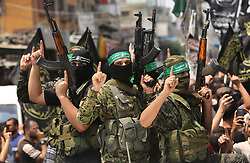 August 17, 2017 - Rafah, Gaza Strip, Palestinian Territory - Palestinian Hamas militants attend the funeral of Nidal al-Jaafari, a 28-year-old field commander who was killed overnight in a suicide attack that targeted forces near the Gaza Strip's crossing with Egypt, in Rafah, southern Gaza Strip.   (Credit Image: © Ashraf Amra/APA Images via ZUMA Wire)