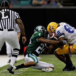 Sep 26, 2009; New Orleans, LA, USA; Tulane Green Wave safety Chinonso Echebelem (24) rips the ball away from McNesse State Cowboys wide receiver Immanuel Friddle (88) at the Louisiana Superdome. Tulane defeated McNeese State 42-32. Mandatory Credit: Derick E. Hingle-US PRESSWIRE
