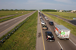 22 Sept 2005. New Orleans, Louisiana.  Hurricane Rita evacuation. <br /> Traffic backs up on the east bound Interstate 10 outside Beaumont near the Texas/louisiana border as residents ironically flee toward New Orleans away from the projected path of Hurricane Rita.<br /> Photo; ©Charlie Varley/varleypix.com