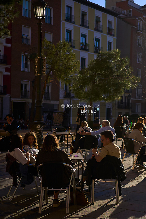 People sit at a bar's terrace in Madrid on March 12, 2021<br /> Young people from Europe Countries, mostly from France are pouring into the heart of Madrid, packing the terraces of cafes, wandering through fashionable streets and booking Airbnbs