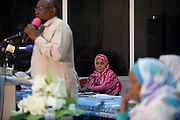A lady official attending the first-ever international Conference on Womens' Challenge in Darfur, listens to a speech by the Govenor of North Darfur, Osman Mohammed Yousef Kibir who addresses the first-ever international Conference on Womens' Challenge in Darfur. The women have gathered in the Govenor's compound in Al Fasher (also spelled, Al-Fashir) where the women from remote parts of Sudan gathered to discuss peace and political issues.