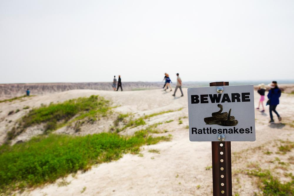 sign warning of rattlesnakes at Badlands National Park in South Dakota