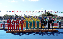Australia's (Centre) Jacob Birtwhistle, Ashleigh Gentle, Matthew Hauser and Gillian Backhouse celebrate winning gold with England's Alistair Brownlee, Jessica Learmonth, Jonathan Brownlee and Vicky Holland (Silver) and New Zealand's Tayler Reid, Andrea Hewitt, Ryan Sissons and Nicole Van Der Kaay (Bronze) during the Mixed Team Relay Triathlon final at the Southport Broadwater Parklands during day three of the 2018 Commonwealth Games in the Gold Coast, Australia.