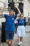NHS Wales nurse Matthew Tovey and other NHSPay15 campaigners celebrate after presenting their petition signed by over 800,000 people calling for a 15% pay rise for NHS workers at 10 Downing Street on 20th July 2021 in London, United Kingdom. At the time of presentation of the petition, the government was believed to be preparing to offer NHS workers a 3% pay rise in recognition of the unique impact of the pandemic on the NHS.