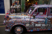 Pearly King of St Pancras with his Pearly taxi cab. Pearly Kings and Queens in London. Seen here in Greenwich, and known as pearlies, they are an organised charitable tradition of working class culture in London, England. Today, around 30 Pearly Families continue the tradition to raise money for various charities. Each London Borough has a King and Queen, as do the City of London and the City of Westminster. It's a colourful London tradition and one that has been kept alive by a few dedicated people, who remain figureheads for the capital's working class communities.