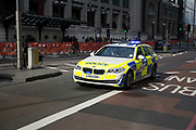 Police car passes at speed in the City of London. The City of London Police is the territorial police force responsible for law enforcement within the City of London, England. The service responsible for law enforcement within the rest of Greater London is the Metropolitan Police Service, a separate organisation. The City of London, which is now primarily a financial centre with a small resident population but a large commuting workforce, is the historic core of London, and has an administrative history distinct from that of the rest of the metropolis, of which its separate police force is one manifestation.