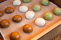 Manju is a popular traditional Japanese confection. There are many varieties but most have an outside made from flour, rice powder and buckwheat with a filling of red bean paste, made from boiled azuki beans and sugar.