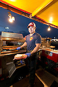 """Aureliano Dominguez owner of """"El Caprichoso"""" Sonora Mexico style hot dogs poses for a photo in downtown Phoenix on August 19, 2016."""