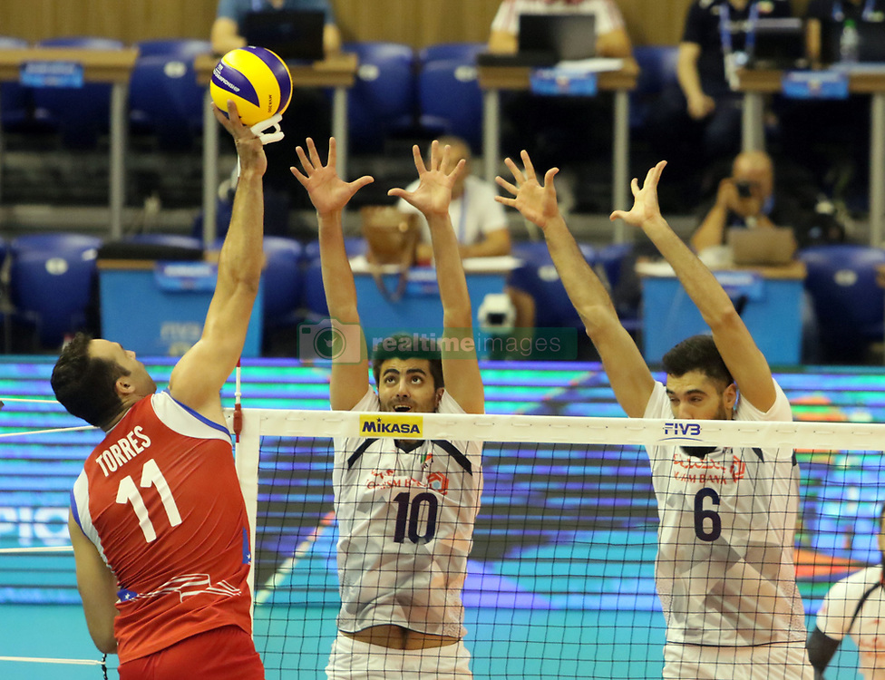September 12, 2018 - Varna, Bulgaria - from left Maurice TORRES (Puerto Rico), Amir GHAFOUR (Iran), Seyed Mohammad ERAGHI (Iran), .FIVB Volleyball Men's World Championship 2018, pool D, Iran vs Puerto Rico,. Palace of Culture and Sport, Varna/Bulgaria, .the teams of Finland, Cuba, Puerto Rico, Poland, Iran and co-host Bulgaria are playing in pool D in the preliminary round. (Credit Image: © Wolfgang Fehrmann/ZUMA Wire)