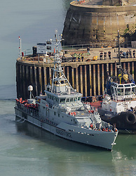 © Licensed to London News Pictures. 17/09/2021. Dover, UK.  Migrants are brought ashore on a Border Force boat at Dover Harbour in Kent. Migrants are continuing to attempt the crossing from France as the weather improves this week. Photo credit: Stuart Brock/LNP