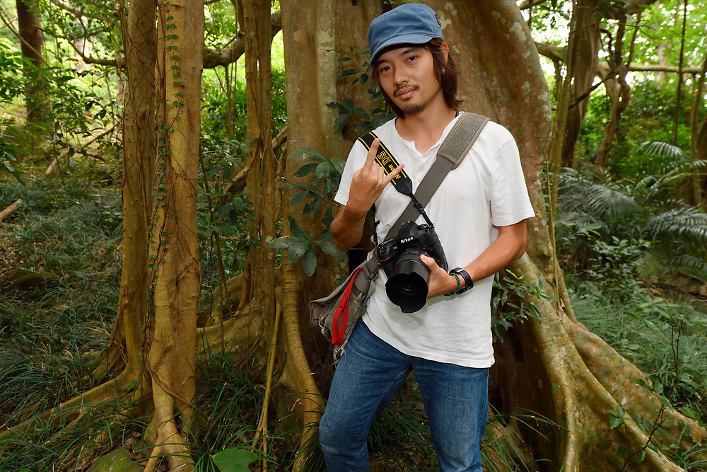 David Lin, in front of Bayan fig tree, (Ficus benjamina), only one single individual tree, Bayan garden protected forest, Kenting National Park, Taiwan