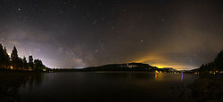"""""""Milky Way Above Donner Lake 5"""" - Very wide angle stitched panoramic photo of Donner Lake at night. The Milky Way can be seen looking to the east, and Donner Summit can be seen looking to the west."""