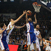 Anadolu Efes's Milko Bjelica (C) and Fenerbahce Ulker's Semih Erden (2ndR) during their Turkish Airlines Euroleague Basketball Top 16 Round 7 match Anadolu Efes between Fenerbahce Ulker at Abdi ipekci arena in Istanbul, Turkey, Friday 13 February, 2015. Photo by Aykut AKICI/TURKPIX