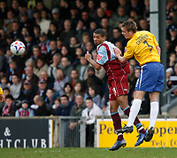 Photo: Steve Bond.<br />Scunthorpe United v Nottingham Forest. Coca Cola League 1. 10/03/2007. Luke chambers beats Jermaine Beckford in the air
