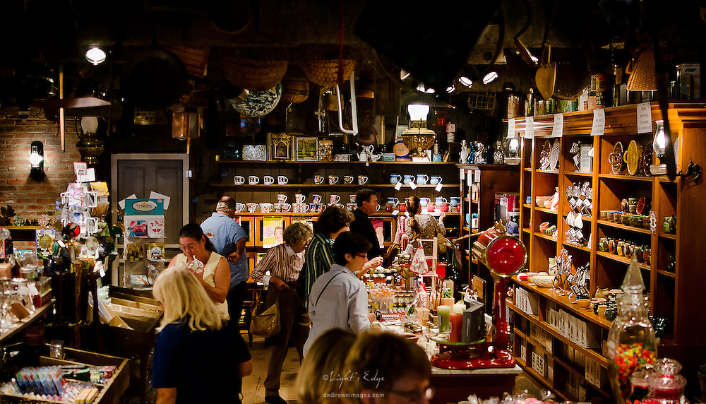 Visitors browse through a store at  Wheaton Arts during the 2012 Fine Craft Festival.
