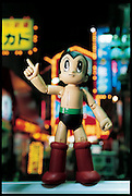Many Japanese roboticists were inspired as a child by Tetsuwan Atomu (Astro Boy), a popular Japanese cartoon about a futuristic robot boy who helps human beings (here, it is a 15-centimeter Astro Boy action figure). Astro Boy, drawn in the 1950's, will soon be the star of a major motion picture. In the story line, his birthdate is in April of 2003. Japan. From the book Robo sapiens: Evolution of a New Species, page 197.