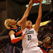 Stefanie Dolson, Connecticut, rebounds over Elashier Hall, Syracuse, during the Connecticut V Syracuse Semi Final match during the Big East Conference, 2013 Women's Basketball Championships at the XL Center, Hartford, Connecticut, USA. 11th March. Photo Tim Clayton