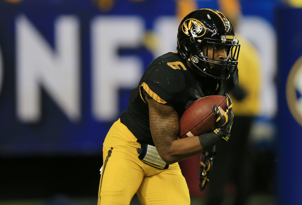 Dec 6, 2014; Atlanta, GA, USA; Missouri Tigers running back Marcus Murphy (6) runs the ball during the first quarter of the 2014 SEC Championship Game against the Alabama Crimson Tide at the Georgia Dome. Mandatory Credit: Kevin Liles-USA TODAY Sports