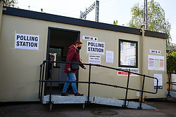 © Licensed to London News Pictures. 06/05/2021. London, UK. A voter wearing a face covering leaves the portacabin polling station in Haringey, North London after casting the vote in the London Mayoral Election. Polling stations have opened as Londoners vote for the next Mayor of London. Photo credit: Dinendra Haria/LNP