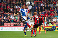 Joshua King of Blackburn Rovers (l) and Simon Francis going for the ball in the air during the Skybet Championship match , AFC Bournemouth v Blackburn Rovers at The Goldsands Stadium in Bournemouth, England on Saturday 28th September 2013. Picture by Sophie Elbourn/Andrew Orchard Sports Photography.