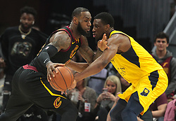 April 18, 2018 - Cleveland, OH, USA - The Cleveland Cavaliers' LeBron James, left, drives against the Indiana Pacers' Thaddeus Young in the first quarter of Game 2 of a first-round NBA playoff series on Wednesday, April 18, 2018, at the Quicken Loans Arena in Cleveland. (Credit Image: © Leah Klafczynski/TNS via ZUMA Wire)