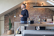 Architect Simon Astridge in the kitchen of his newly renovated Tufnell Park flat in London. CREDIT: Vanessa Berberian for The Wall Street Journal. BALANCE SHEET - Astridge
