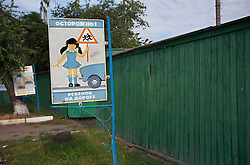 A road sign is seen outside of the local primary school in Zinkiv, Ukraine, June 17, 2011. Some of the community paralegals also work as teachers, where they meet many of the community members in need of legal advice. More than half of the worldÕs population, four billion people, live outside the rule of law, with no effective title to property, access to courts or redress for official abuse. The Open Society Justice Initiative is involved in building capacity and developing pilot programs through the use of community-based advocates and paralegals in Sierra Leone, Ukraine and Indonesia. The pilot programs, which combine education with grassroots tools to provide concrete solutions to instances of injustice, help give poor people some measure of control over their lives.
