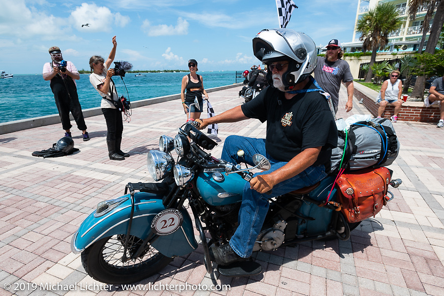 Don Gilmore riding his 1940 Indian Chief over the finish line of the Cross Country Chase motorcycle endurance run from Sault Sainte Marie, MI to Key West, FL. (for vintage bikes from 1930-1948). The Grand Finish in Key West's Mallory Square after the 110 mile Stage-10 ride from Miami to Key West, FL and after covering 2,368 miles of the Cross Country Chase. Sunday, September 15, 2019. Photography ©2019 Michael Lichter.