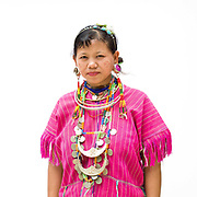 Som 20 an ethnic Kayaw woman from Myanmar at Baan Tong Luang, Eco-Agricultural Hill Tribes Village on 7th June 2016 in Chiang Mai province, Thailand. The fabricated village is home to 8 different hill tribes who make a living from selling their handicrafts and having their photos taken by tourists