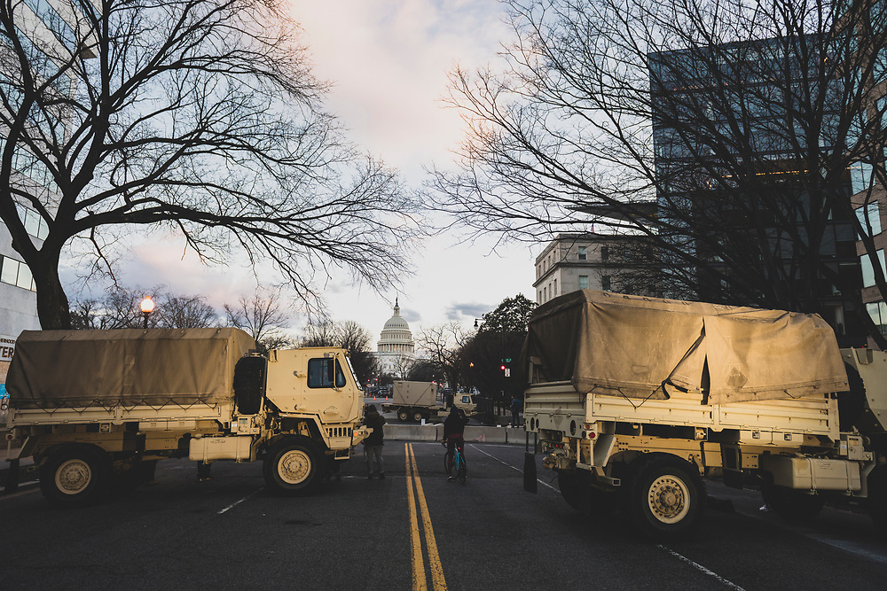 Washington DC, USA - January 18, 2021: National Guard vehicles parked on New Jersey Avenue NW outside the Hyatt Regency.