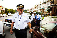 Philadelphia Police Commisioner Charles Ramsey looks around a neighborhood while police officers detain a suspected drug dealer in Philadelphia on Aug. 13, 2008.